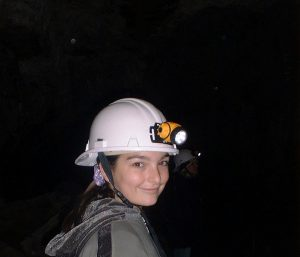 Girl Caving Waitomo New Zealand Abigail Simpson