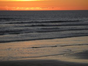 Sunset on Ninety Mile Beach Free Trip Planner New Zealand